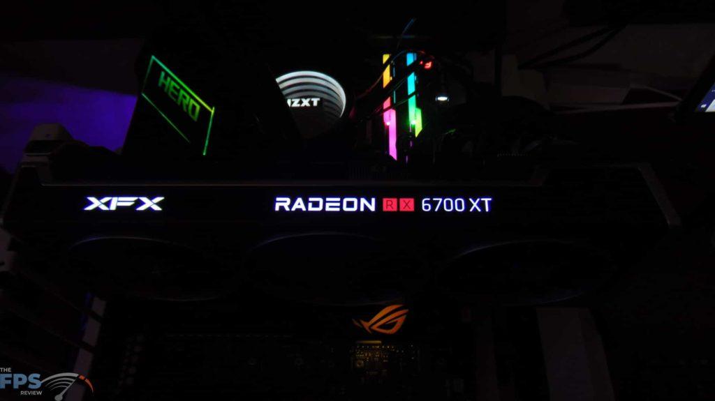 XFX SPEEDSTER MERC 319 BLACK AMD Radeon RX 6700 XT top view rgb lighting in the dark