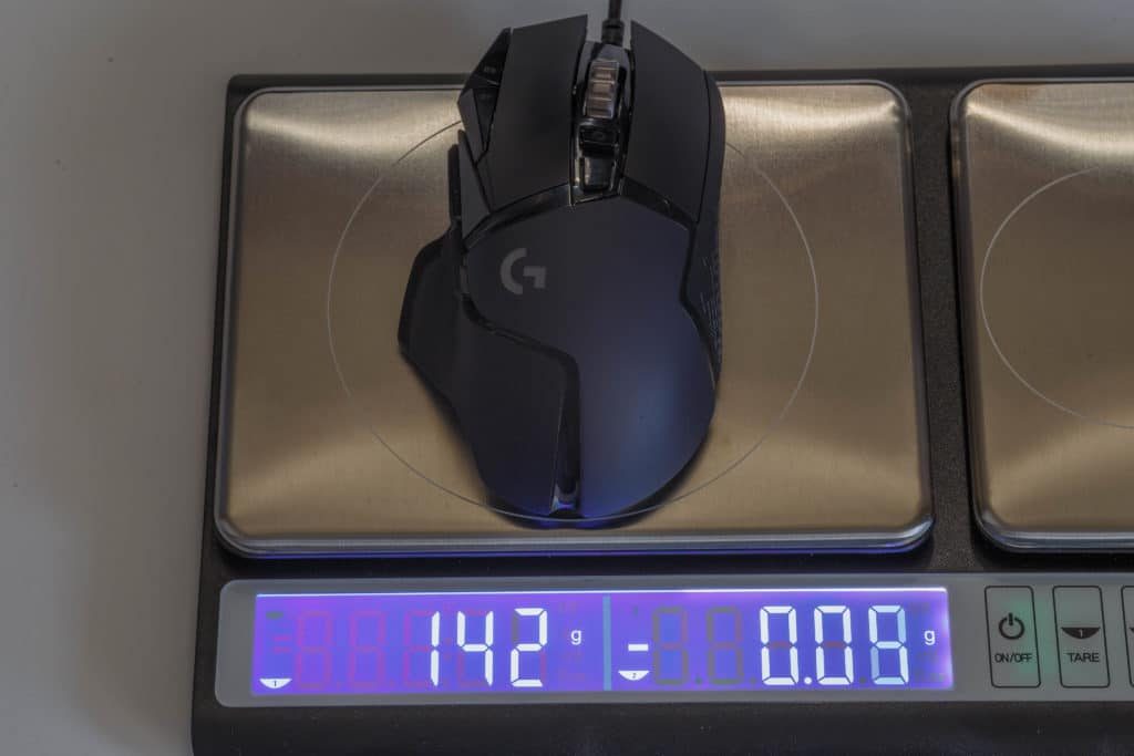 Logitech G502 HERO High Performance Gaming Mouse on scale with weights